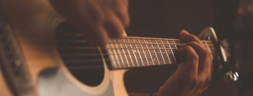 Guitar by Jefferson Santos on Unsplash: Roomies by Christina Lauren (The Modest Reader)
