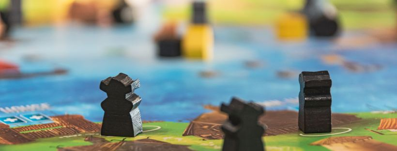 Games by Christopher Paul High on Unsplash: Make Your Move by Laura Heffernan (The Modest Reader)