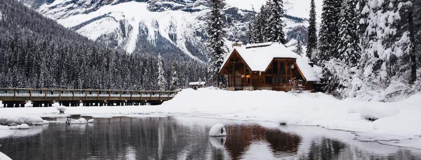 Winter Cabin by Ezra Jeffrey Comeau on Unsplash: In A Holidaze by Christina Lauren (The Modest Reader)